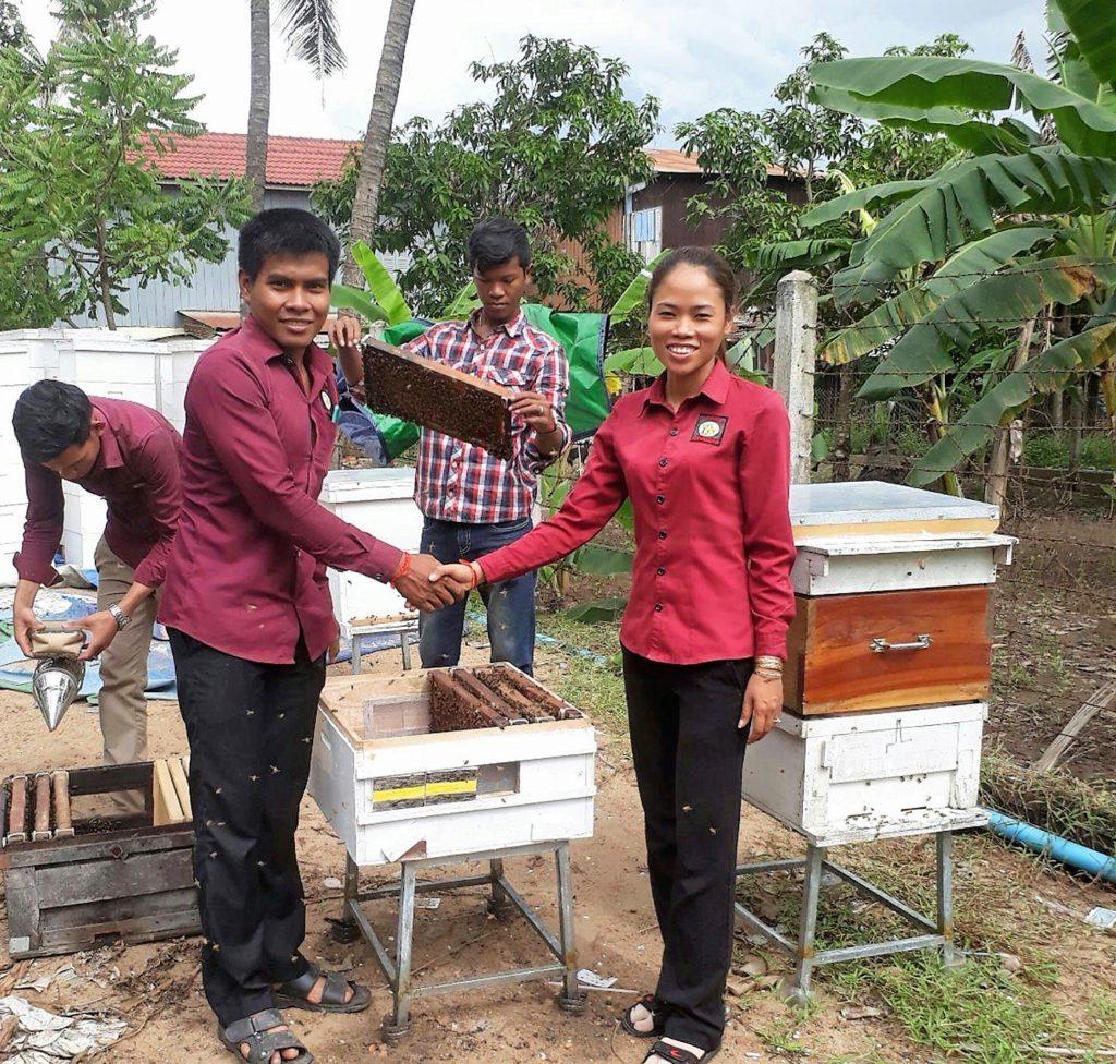 Choub Sokheng receiving his Bees
