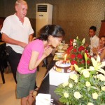 Kasna blowing out the candles.