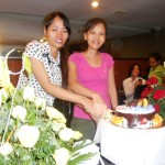 The girls cutting the cake.