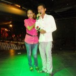 Lyda presenting Sal with a rose.